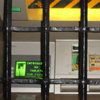 Thumbnail detail of ATM machine with heavy iron bars in front of it.