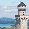 Cropped detail from photo of Neuschwanstein Castle, in Bavaria, Germany, which looks similar to Cinderella's castle in Disney World, used to illustrate both an e-book and an article by Richard Klass with titles such as