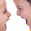 Close-up of two kids yelling at each other, illustrating article by Richard Klass about a dispute between siblings over real estate profits and limited partnerships.
