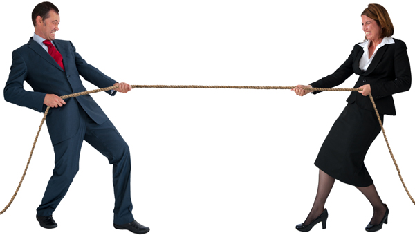 Man and woman with tug of war rope illustrating article by Richard Klass about enforcing judgments against bank accounts held outside New York