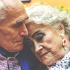 Gray-haired couple in embrace illustrating article by Richard Klass Esq. about Tenancy by the Entirety