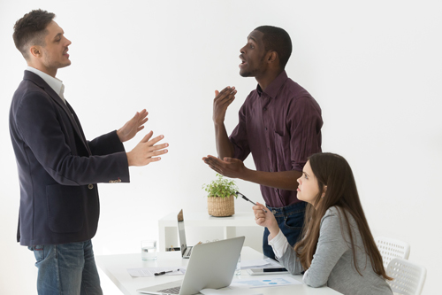 Three business partners arguing to illustrate an article by Richard Klass about Joint Venture Agreements