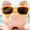 Pink piggy bank wearing yellow sunglasses